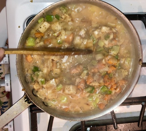 The Chicken stock is in the Peas go in at the last minute so as not to get discolored. Photo by Karen Sue photography.