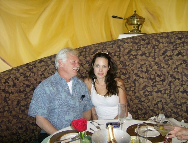 Angelina Jolie and myself drinking Champagne and eating Cold Smoked Salmon.  She enjoyed it the plates are empty !!!