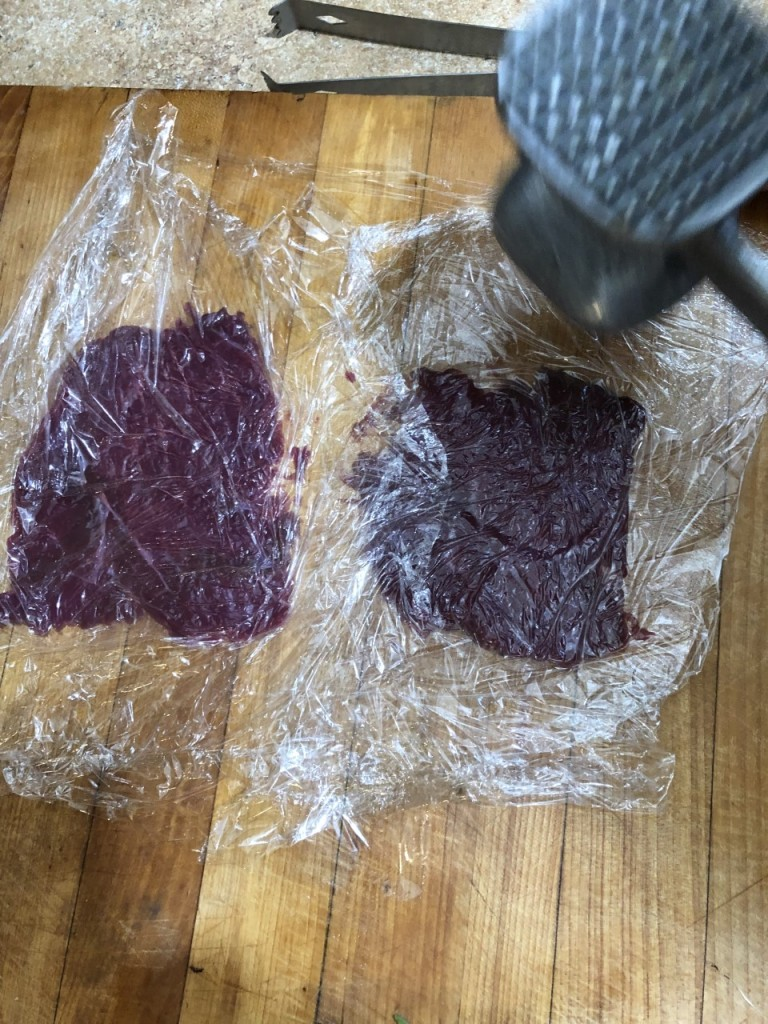 Tenderizing the Venison wrapped in plastic.
