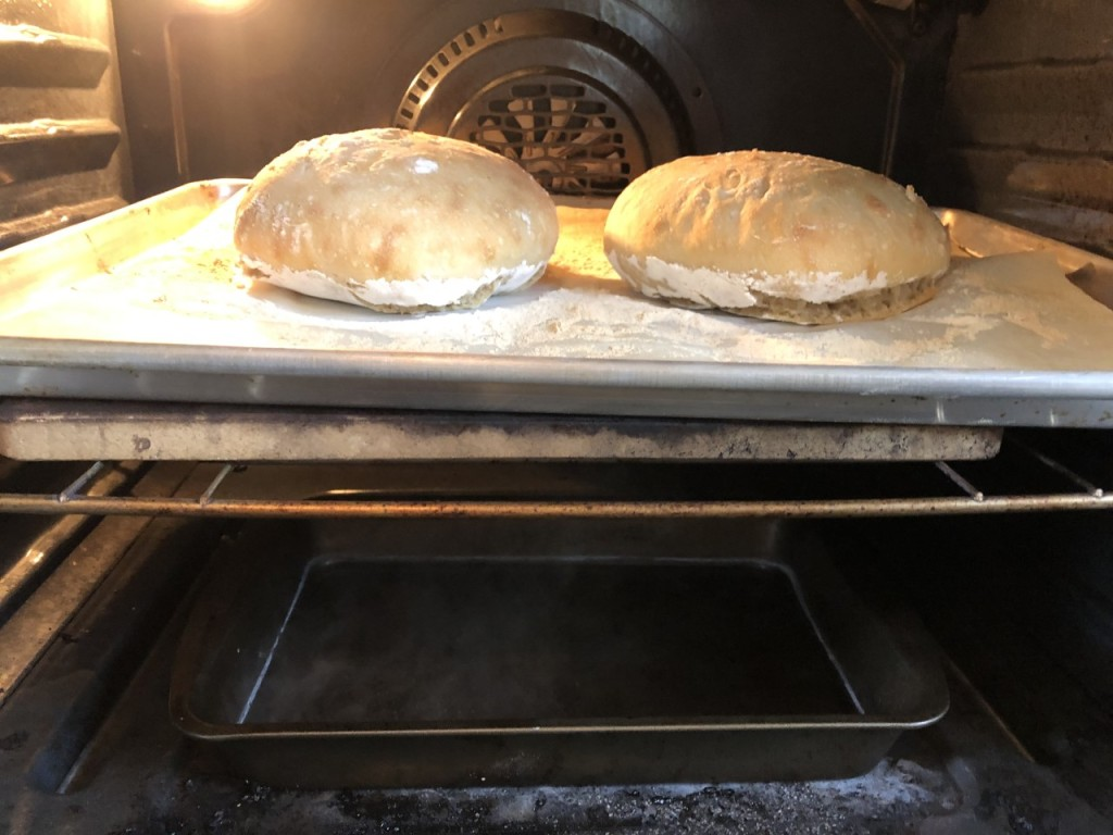 You can see the Steam rising from the baking pan on the bottom and the Bread Baking on top.